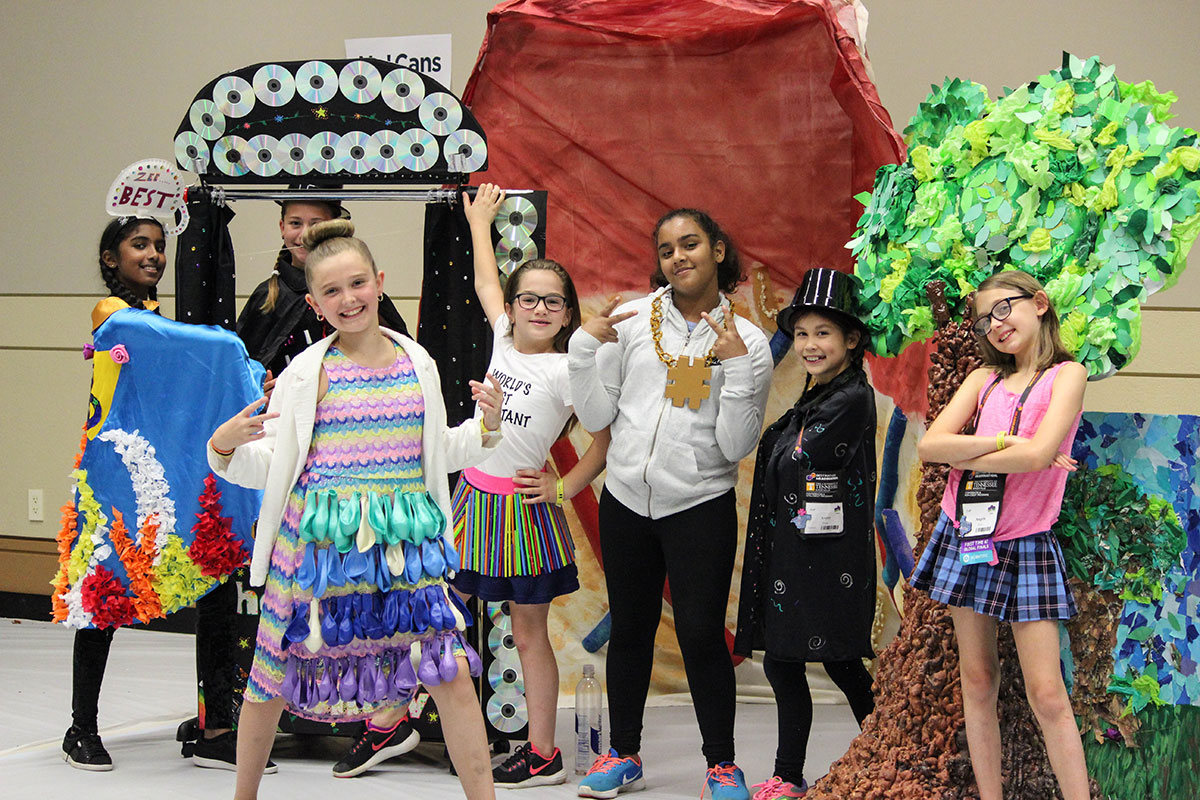 Students posing for a photo during a Destination Imagination tournament