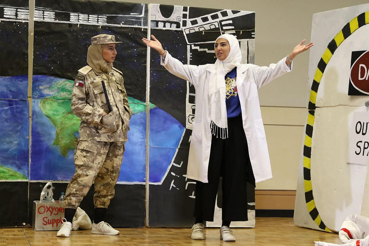 Students participating in a challenge during a Destination Imagination tournament