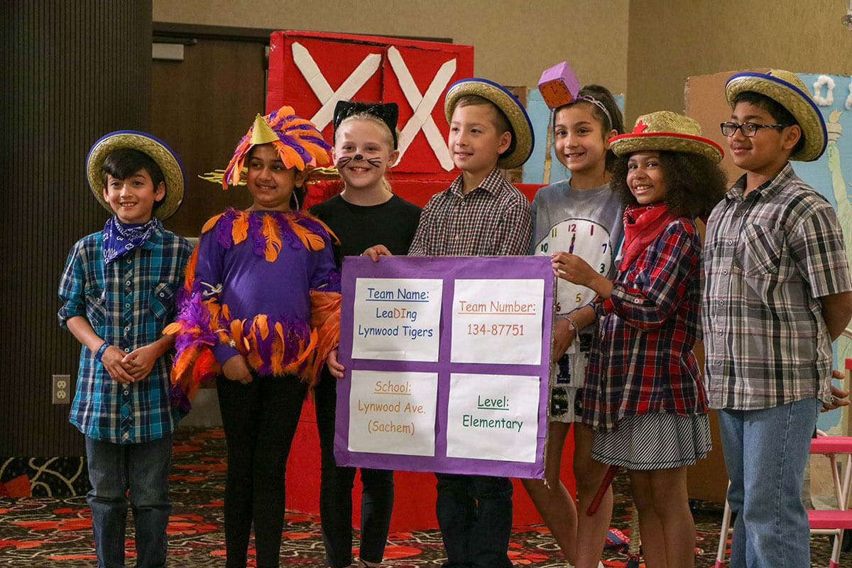Students posing for a photo at a Destination Imagination tournament