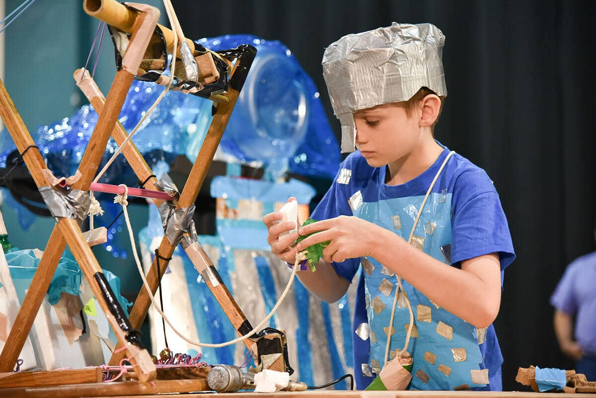 Student participating in a challenge during a Destination Imagination tournament