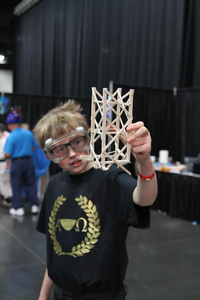 Student showing if prop to the camera during a Destination Imagination tournament