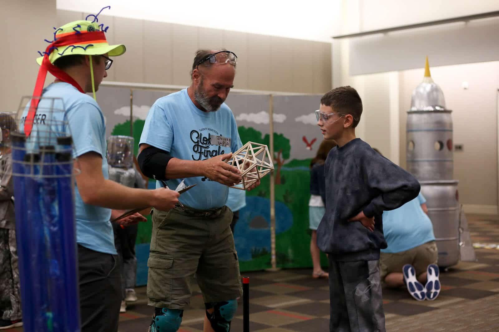 Student talking to a Destination Imagination tournament official